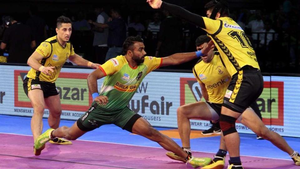Patna Pirates and Telugu Titans players in action during the Pro Kabaddi League.