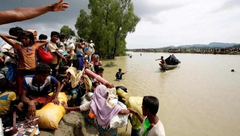 Rohingya refugees wait for boat to cross a canal after crossing the border through the Naf river in Teknaf, Bangladesh, September 7, 2017.