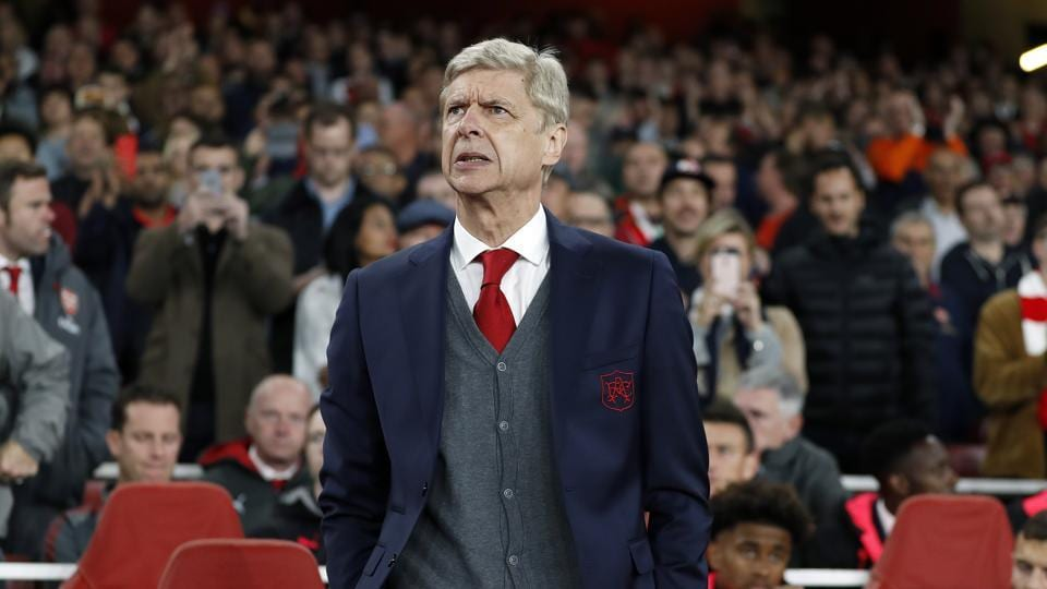 Arsenal manager Arsene Wenger waits for the start of the Europa League group H soccer match between Arsenal and FC Cologne at the Emirates stadium in London, England.