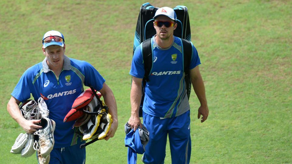 James Faulkner (L) and Travis Head (R) arrive a training session. Both these all-rounders will have a big role to play in the series. (AFP)