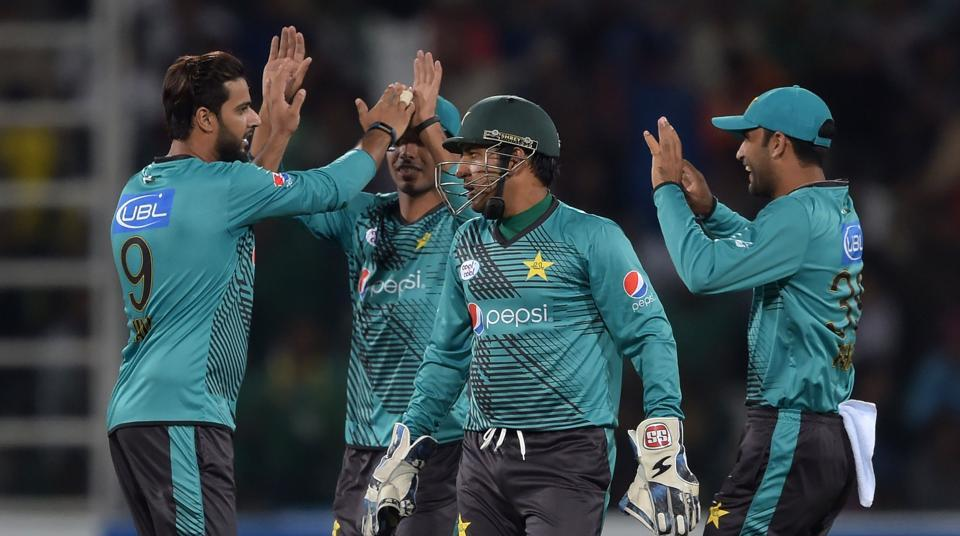 Pakistan cricket team players celebrate during their Independence Cup T20 match against ICCWorld XI at the Gaddafi Cricket Stadium in Lahore.