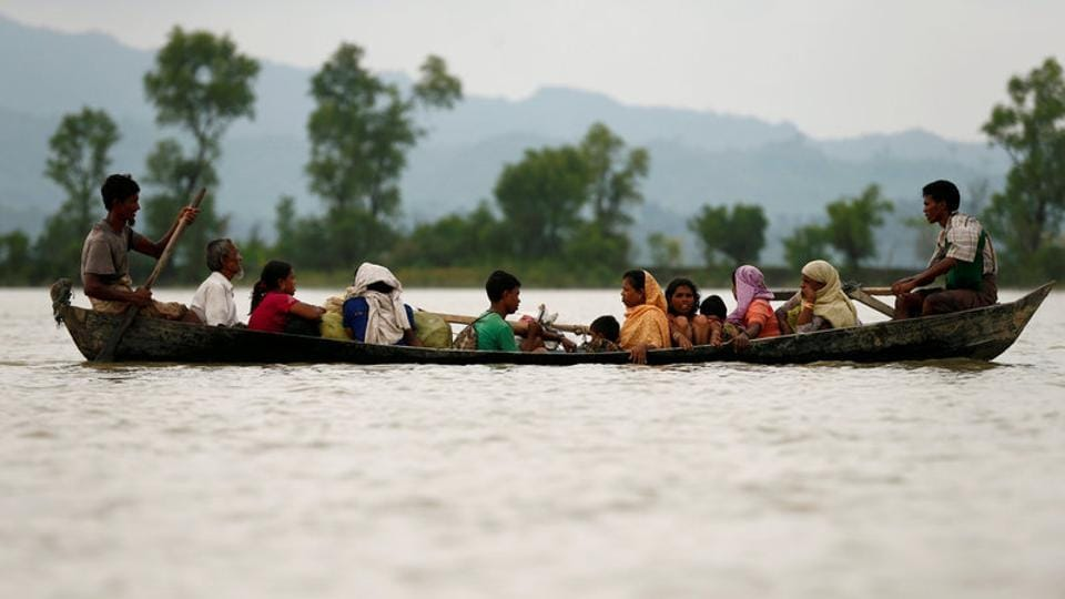 Rohingya refugees are seen on a boat as they are crossing border through the Naf river in Teknaf, Bangladesh, September 7, 2017.