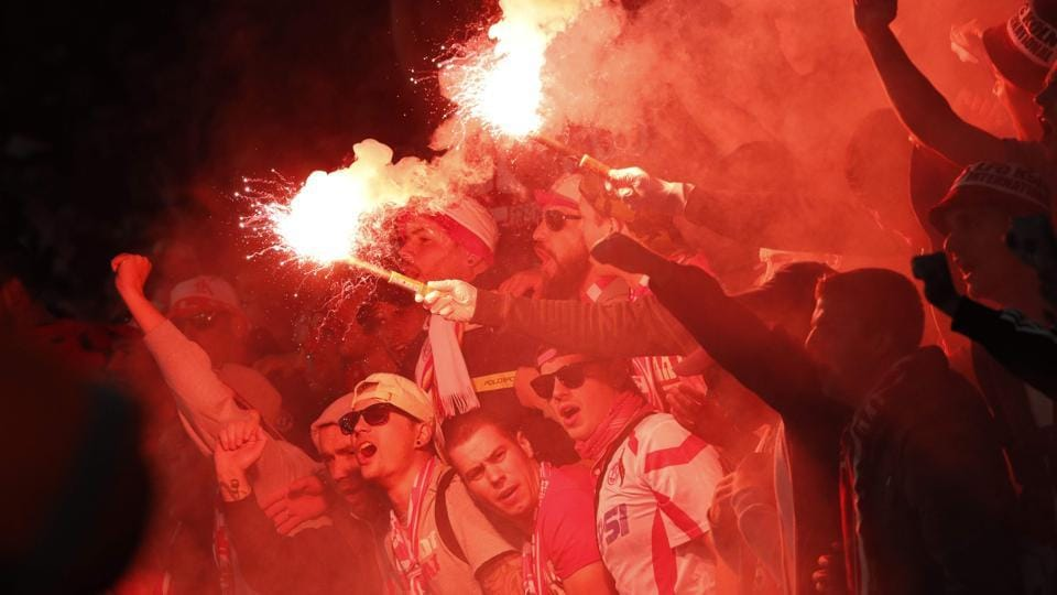 Cologne fans light flares inside the stadium during the UEFA Europa League Group H football match between Arsenal and F.C. Cologne at The Emirates Stadium in London.