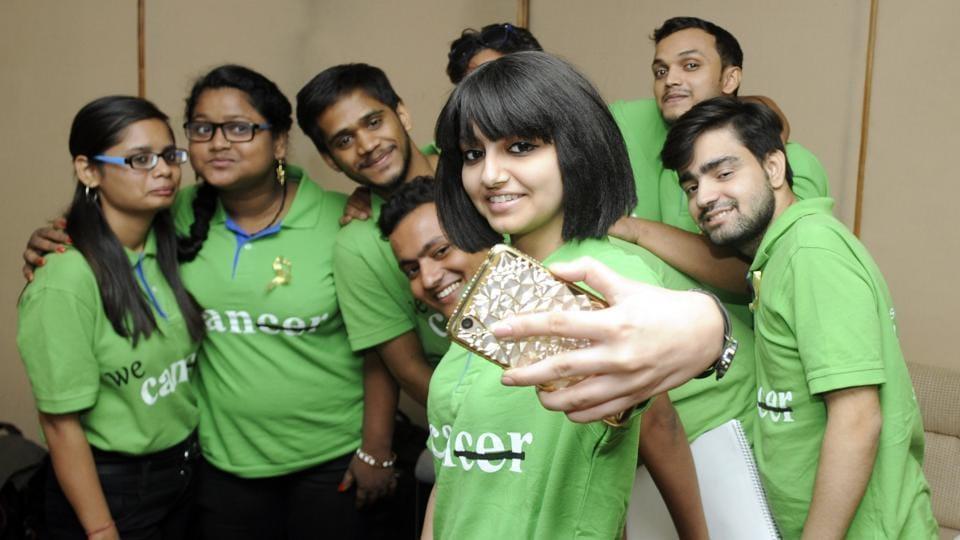 Cancer survivor children taking a selfie during a function in Patiala.