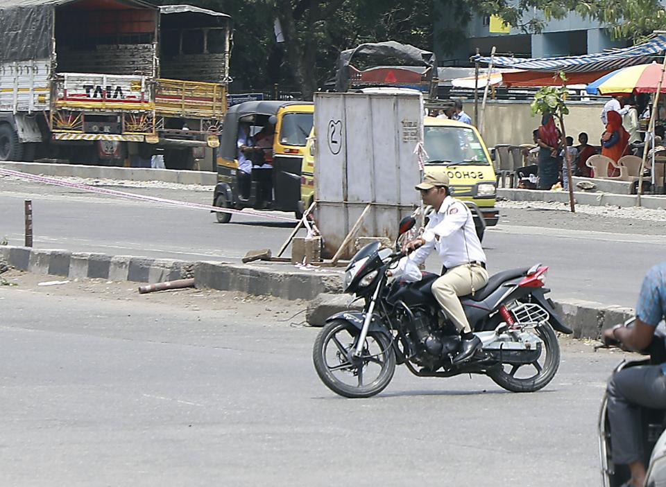 A traffic police rides without a helmet at Katraj in Pune.
