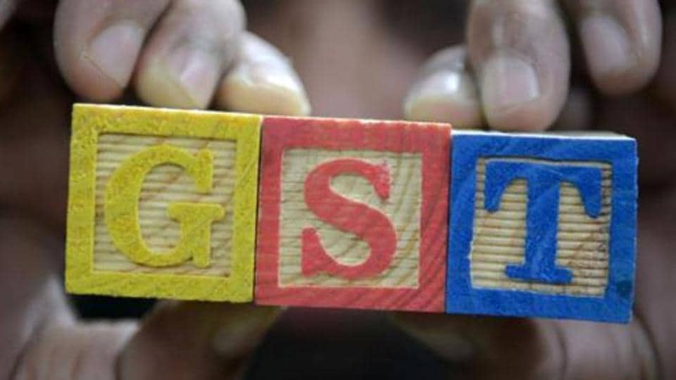 A consumer goods trader shows letters GST representing