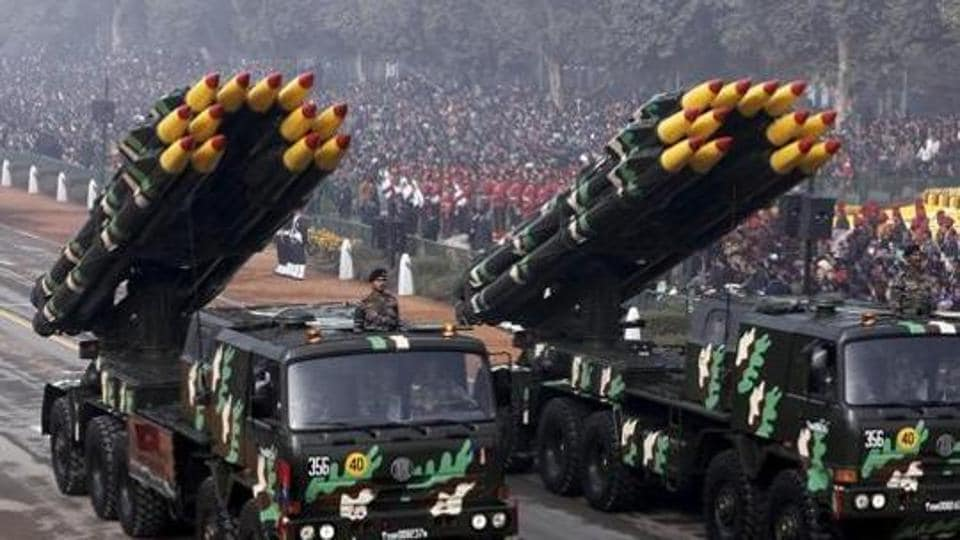 Indian army officers stand on vehicles displaying missiles during the Republic Day parade in New Delhi, January 26, 2016