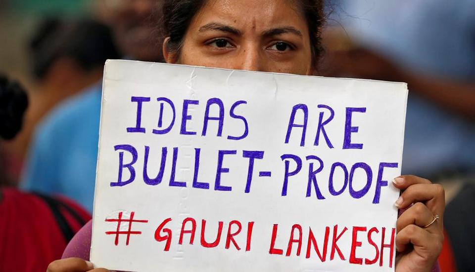 People attend a protest in New Delhi against the killing of Gauri Lankesh, a senior Indian journalist who, according to police, was shot dead outside her home on Tuesday by unidentified assailants in the southern city of Bengaluru, India, September 7, 2017. REUTERS/Cathal McNaughton