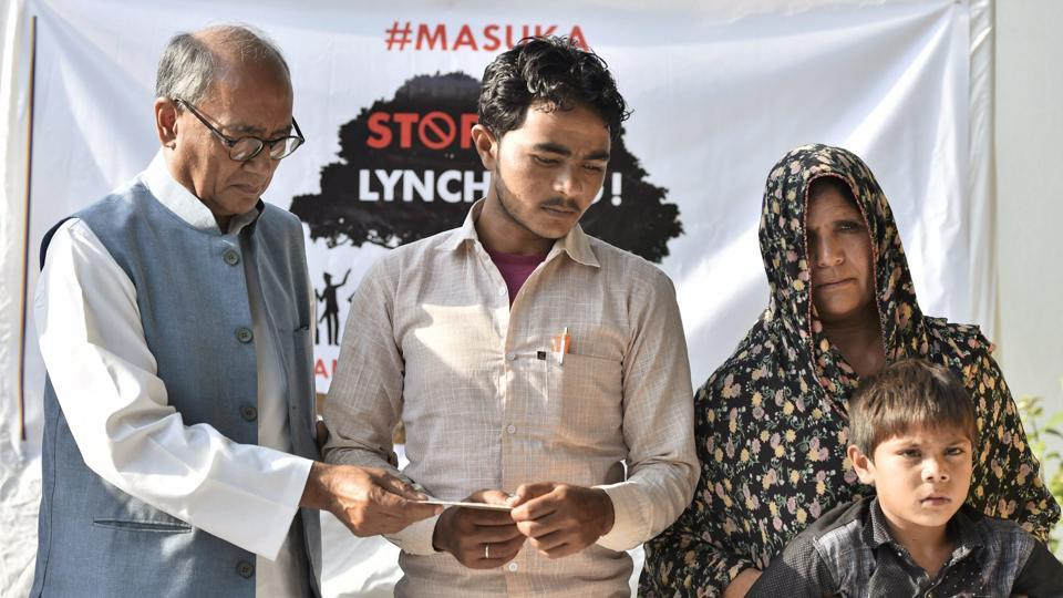 The family of dairy farmer Pehlu Khan, who was lynched by a mob in Alwar in April, at a press conference with Congress leader Digvijaya Singh in New Delhi on Friday.