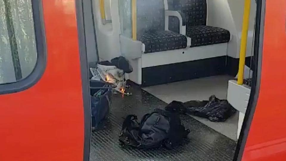 Unverified photos taken inside a District Line train show a white plastic bucket inside a supermarket shopping bag. Flames and what appear to be wires can be seen. Police say it's 'too early to confirm the cause of the fire, which will be subject to the investigation that is now underway by the Met's Counter Terrorism Command.' (Sylvain Pennec / REUTERS)