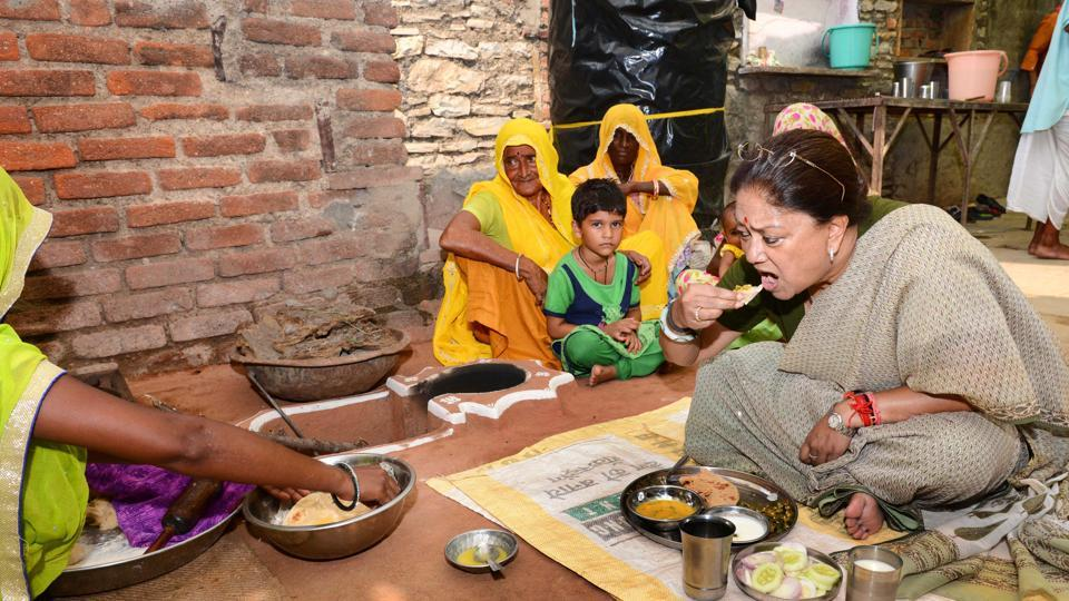 Chief minister Vasundhara Raje having lunch at a Dalit home in Matunda on Friday.