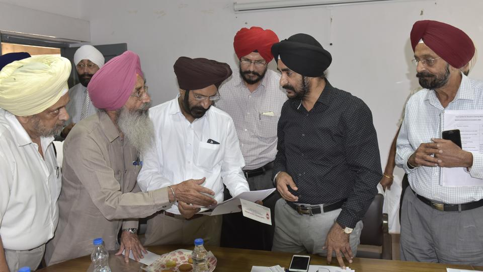 Director industries DPS Kharbanda (in black shirt) interacting with industrialists during a meeting at RND Center in Ludhiana on Friday.