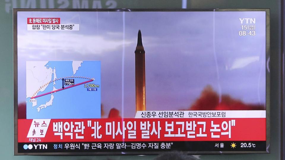People watch a TV screen showing a file footage of North Korea's missile launch, at the Seoul Railway Station in Seoul, South Korea.
