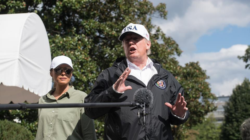 US President Donald Trump speaks to the press with First Lady Melania Trump at the White House in Washington, DC, on September 14, 2017, upon return from Florida following Hurricane Irma.