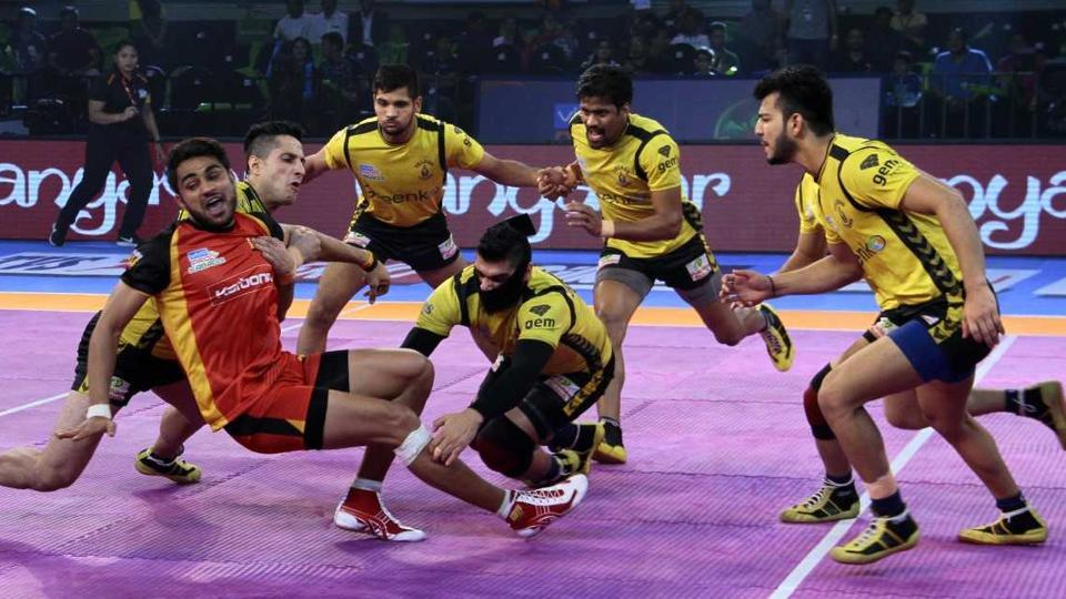 Telugu Titans and Bengaluru Bulls players in action during their Pro Kabaddi League encounter.