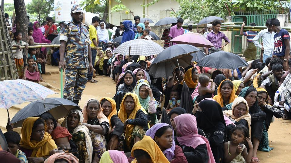Newly arrived Rohingya Muslim refugees wait in line for their registration at a government office in the Bangladeshi town of Ukhia on September 15.