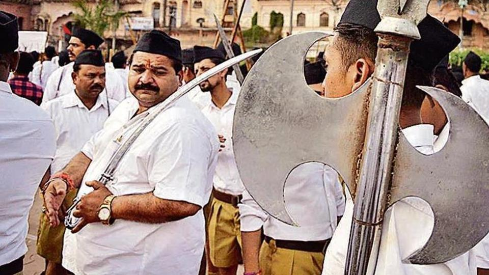RSS workers take part in a shastra puja. A similar event will be held on Bijoya Dasami in West Bengal.