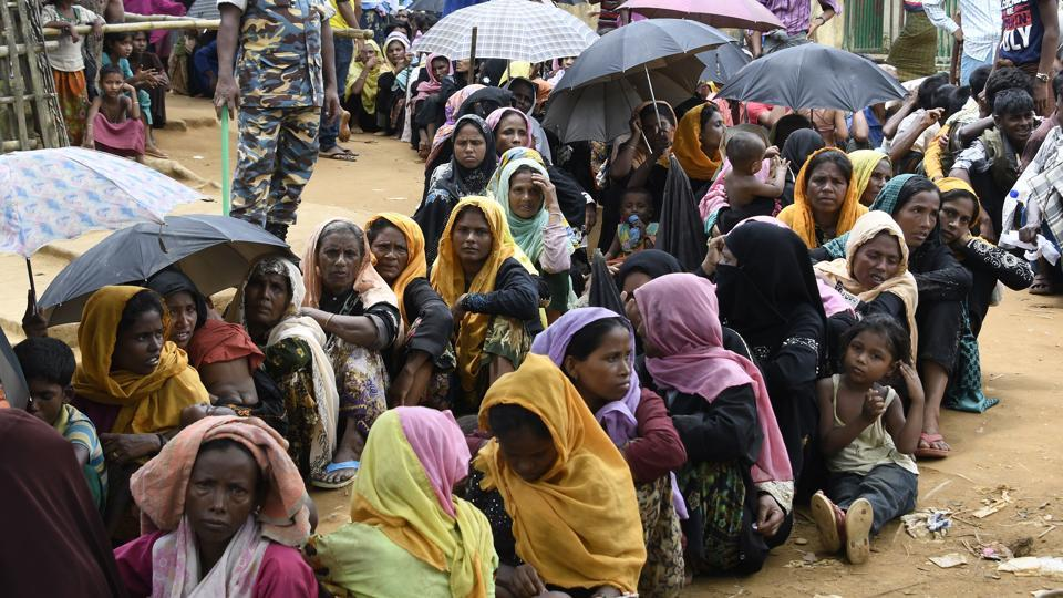 Newly arrived Rohingya Muslim refugees wait in line for their registration at a government office in the Bangladeshi town of Ukhia on September 15, 2017.