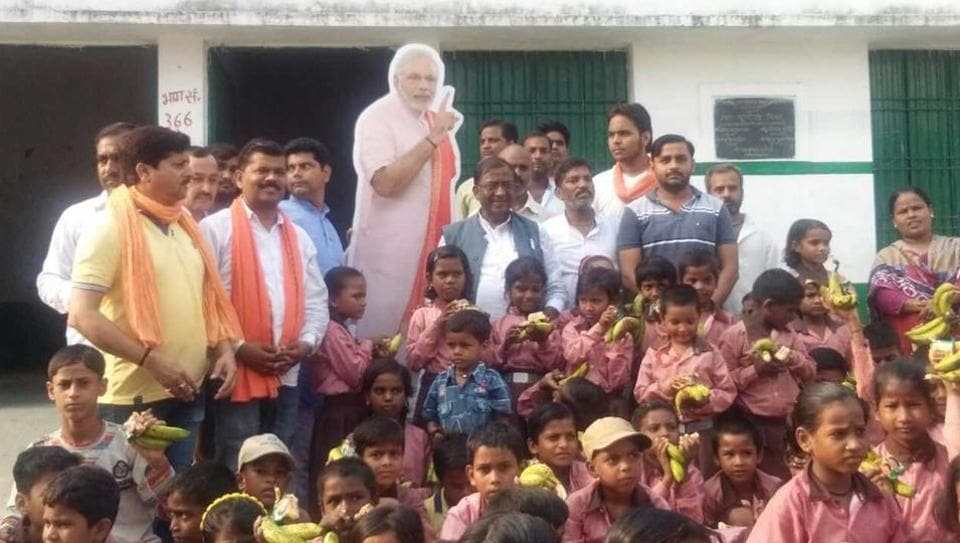 BJP workers put up a cut-out of the Prime Minister at a government school in Varanasi, Modi's constituency.