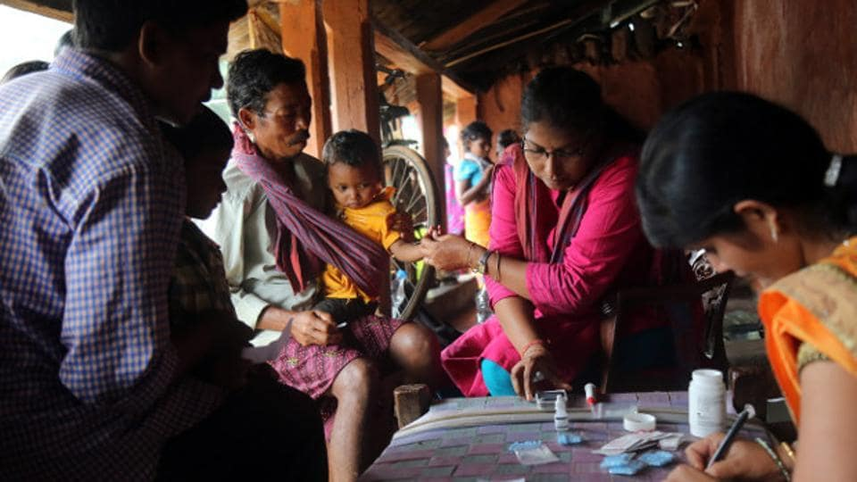 A health worker taking the blood sample of a child at mass screening for malaria at Budabirmaha. Children below five were also screening for anaemia and stunting during the screening.