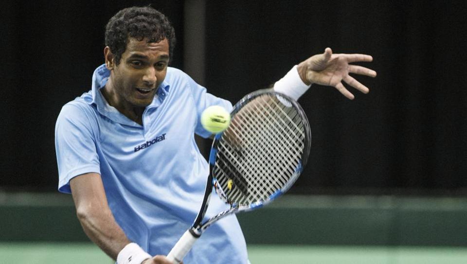 India's Ramkumar Ramanathan returns to Canada's Brayden Schnur during a Davis Cup tennis match in Edmonton, Alberta, Friday, Sept. 15, 2017. (Jason Franson/The Canadian Press via AP) (AP)