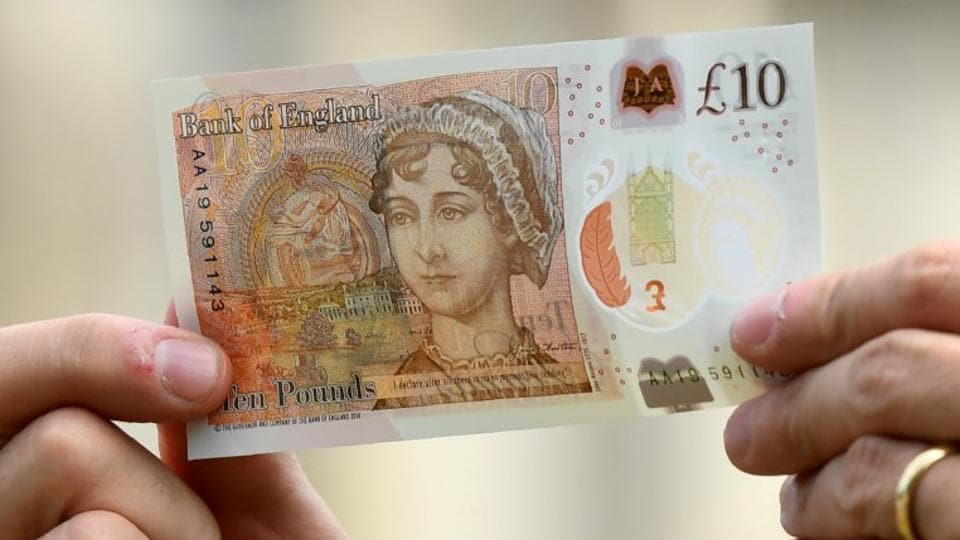 Britain's Bank of England Governor, Mark Carney, holds the new £10 note featuring Jane Austen, at Winchester Cathedral, in Winchester, Britain.