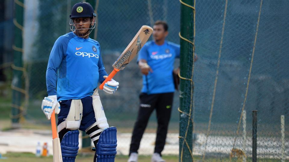 Indian cricketer MS Dhoni gestures during training session ahead of the India-Australia cricket series in Chennai. (AFP)