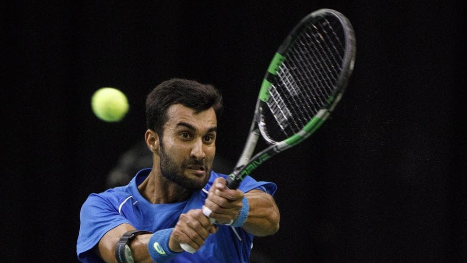India's Yuki Bhambri returns to Canada's Denis Shapovalov during a Davis Cup tennis match in Edmonton, Alberta, Friday, Sept. 15, 2017.