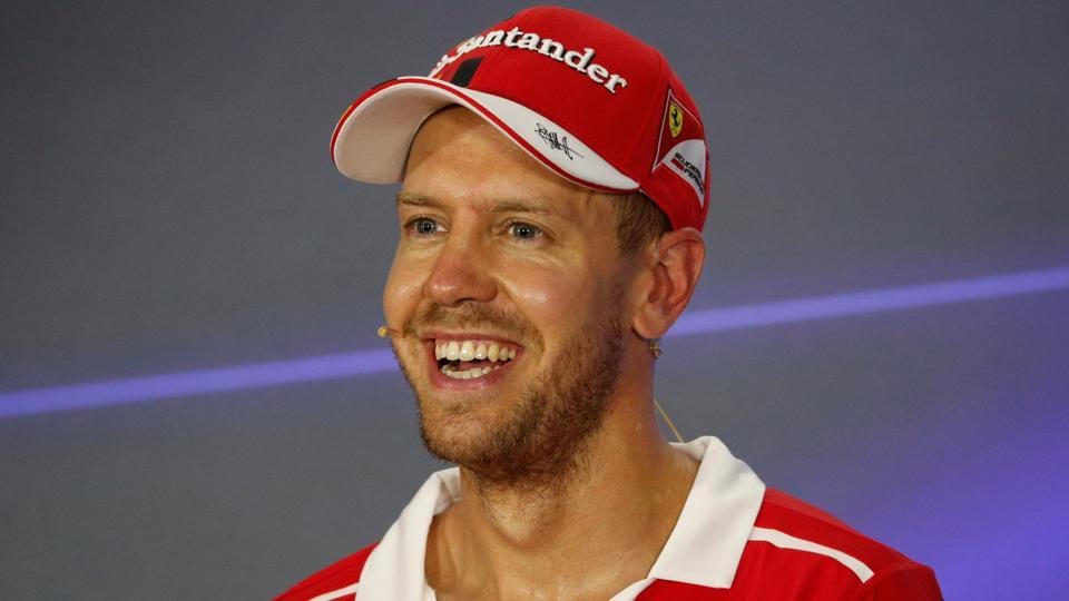 Ferrari's Sebastian Vettel during a press conference after qualifying in pole position at the Singapore Grand Prix.