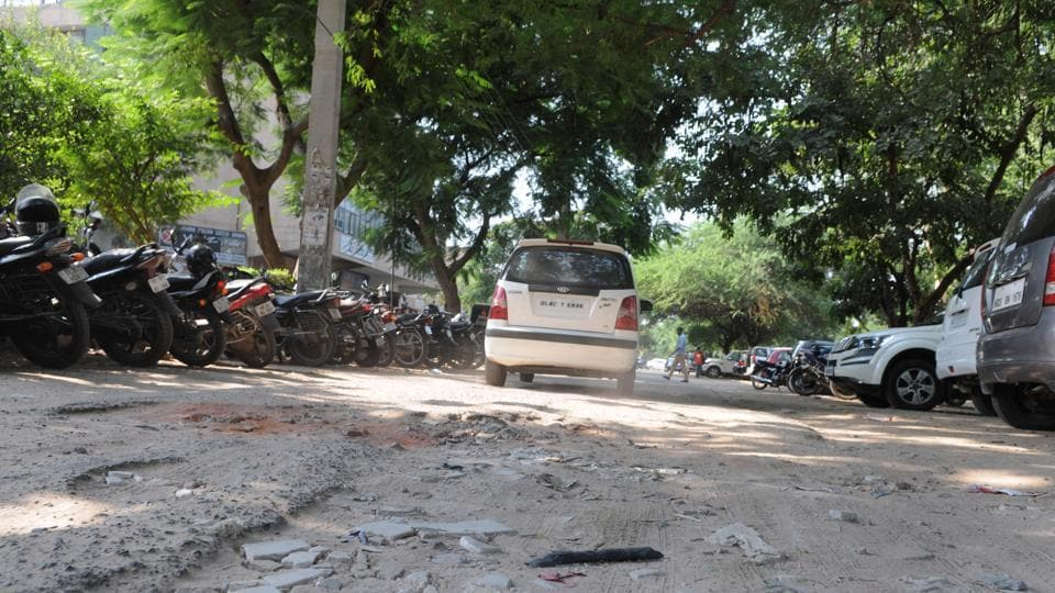 Roads in DLF Phase-1, which is part of ward 34, are badly damaged near Qutub Plaza market.