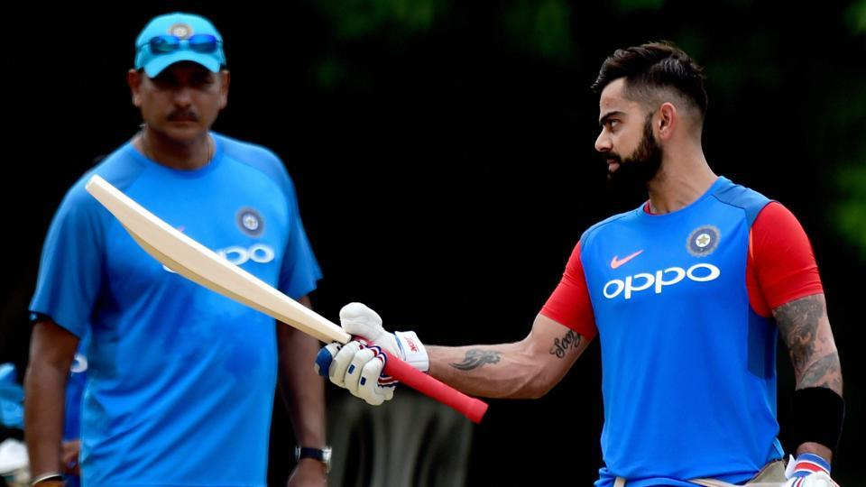 Indian cricket team captain Virat Kohli checks out the balance of his bat as head coach Ravi Shastri looks on during a practice session at MAC Stadium on the eve of the first ODI match against Australia cricket team in Chennai on Saturday.