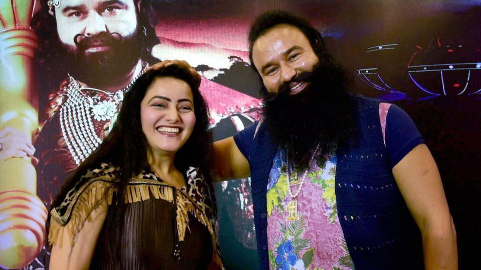 Honeypreet Insan is seen with Gurmeet Ram Rahim Singh at the promotion of the film ''MSG - The Warrior Lion Heart'' in Bengaluru on September  29, 2016.