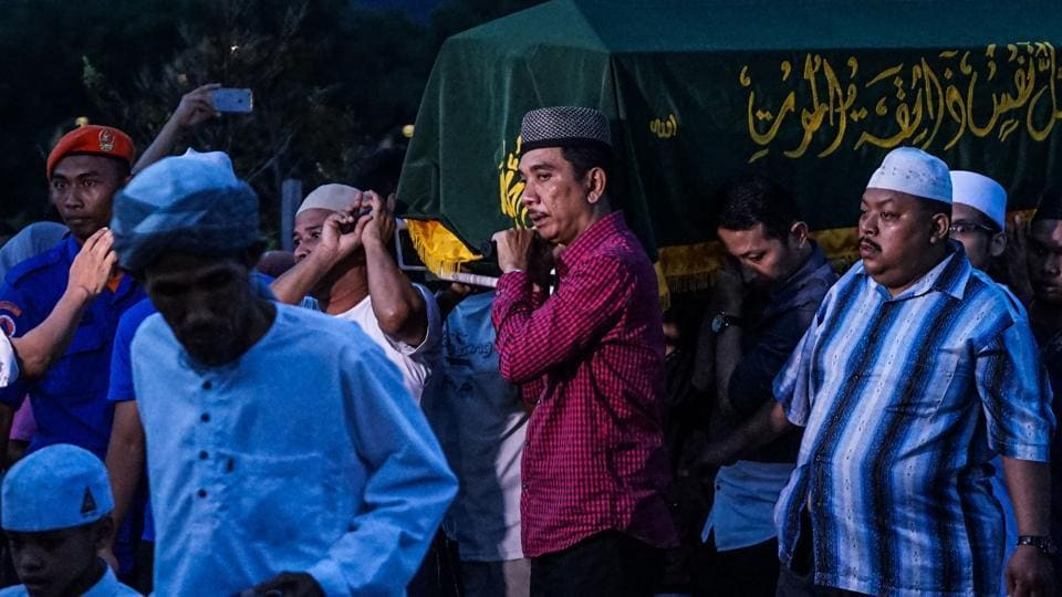 Malaysian Muslims carry the coffin of a victim of the Darul Quran Ittifaqiyah religious school fire for burial at Raudhatul Sakinah cemetery in Kuala Lumpur on September 15.