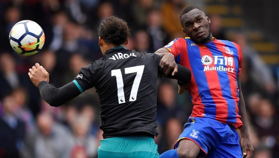 Crystal Palace's Christian Benteke and Southampton's Virgil van Dijk vie for the ball during their Premier League match on Saturday.