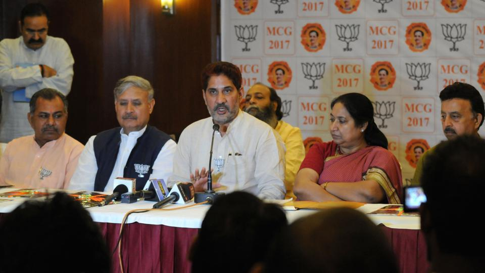 BJP state president Subhash Barala (centre) released on Saturday his party's manifesto for the MCG polls.