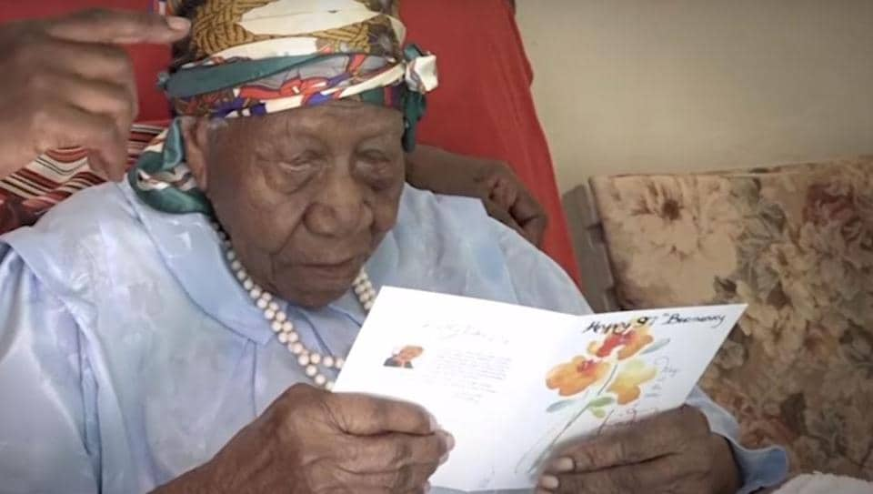 Violet Brown reads a greeting card on her 117th birthday. She celebrated her birthday in March this year.