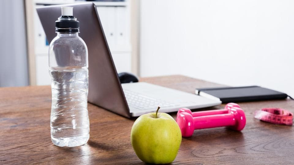 Instead of carrying a big water bottle or thermos, keep your drink in a small mug or glass so you will have to get up from your desk to refill your drink.