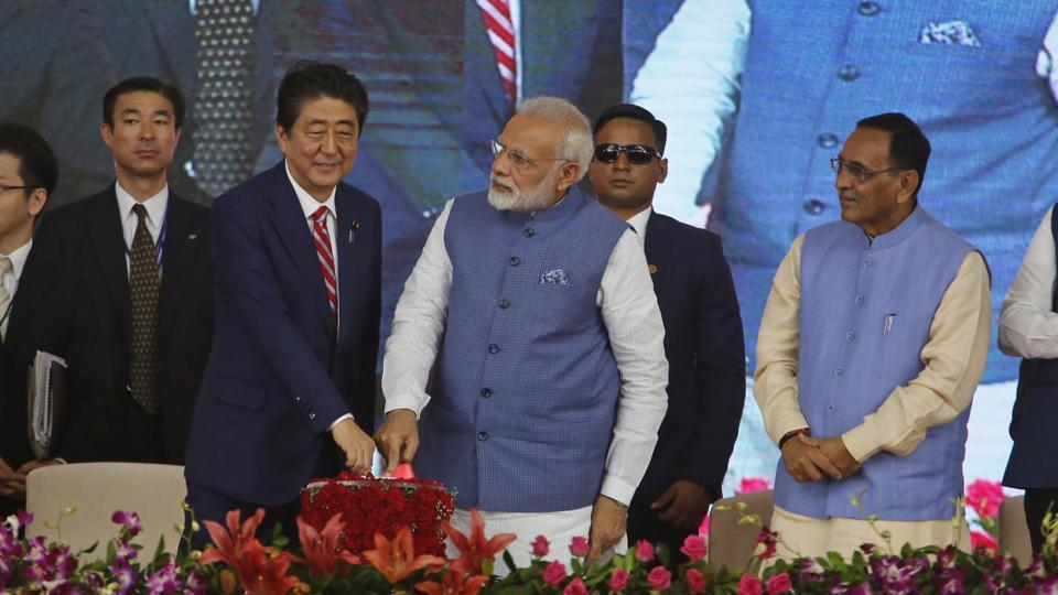 Prime Minister Narendra Modi and his Japanese counterpart Shinzo Abe press a button to launch a high speed rail project in Ahmadabad on September 14.