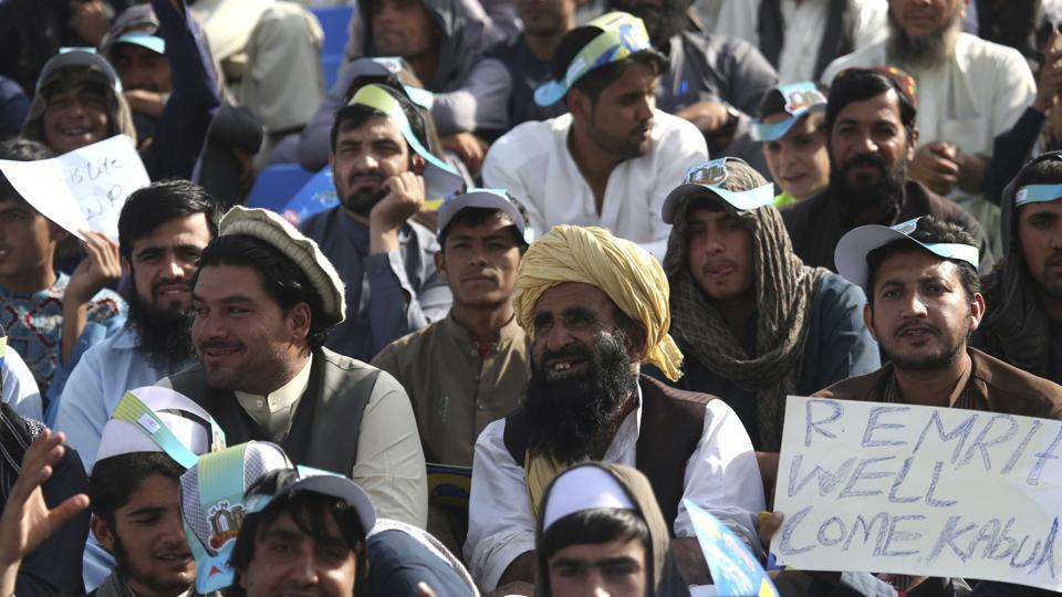 In this Tuesday, Sept. 12, 2017, photo, cricket fans celebrate during Speenghar Tigers' versus Boost Defenders in Kabul, Afghanistan.