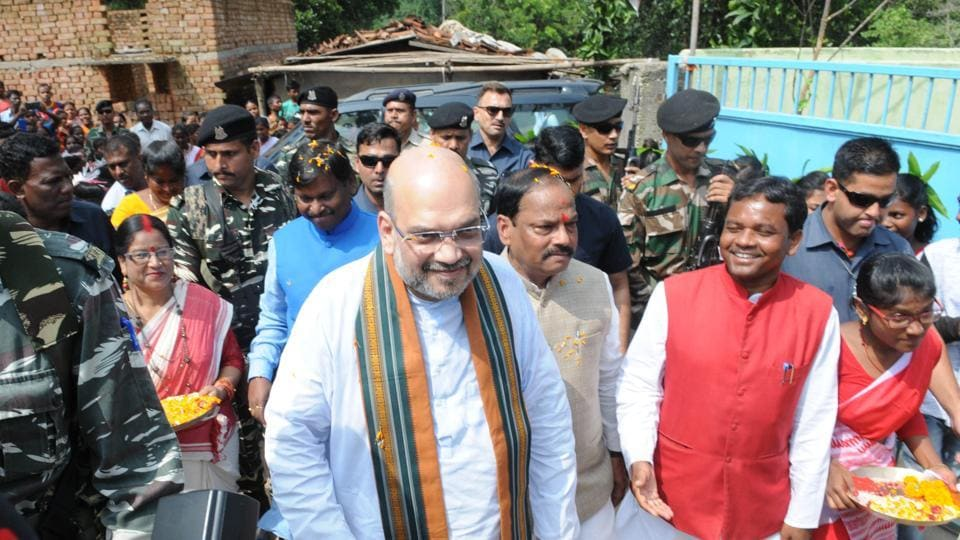 BJP President Amit Shah along with Chief Minister Raghubar Das and Former Chief Minister Arjun Munda visiting the residence of tribal Anil Oraon at Harmu locality in Ranchi, India, on Saturday, September 16, 2017.