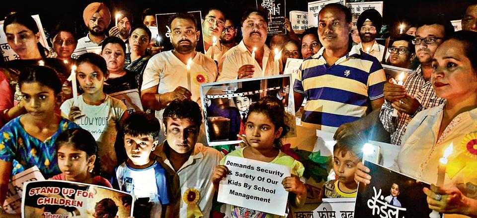 School children and their parents in Chandigarh participate in a candle march  to highlight safety issues after the tragic death of a student in Gurgaon.