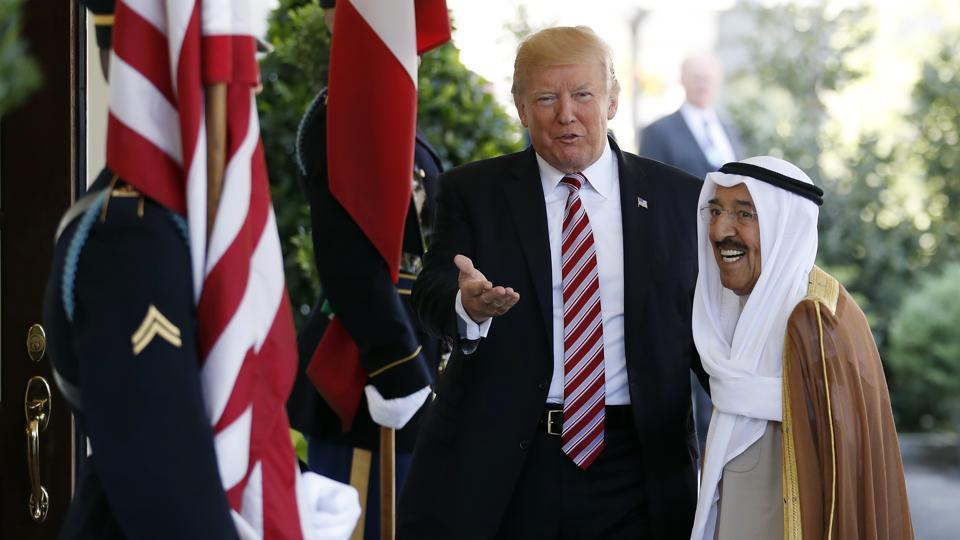 In this Sept. 7, 2017 file photo, President Donald Trump, center, gestures as he greets the Amir of Kuwait Sheikh Sabah Al Ahmad Al Sabah as he arrives at the White House in Washington. Kuwait says it will expel North Korea's ambassador and four other diplomats from its embassy in Kuwait City.