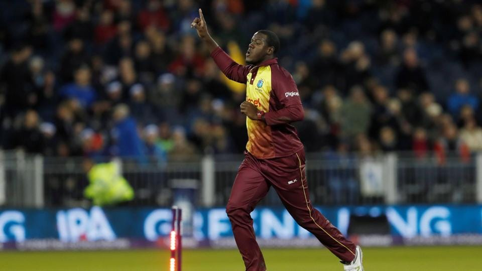 West Indies' Carlos Brathwaite celebrates his wicket of England's Liam Plunkett and victory in the one-off Twenty20 international.