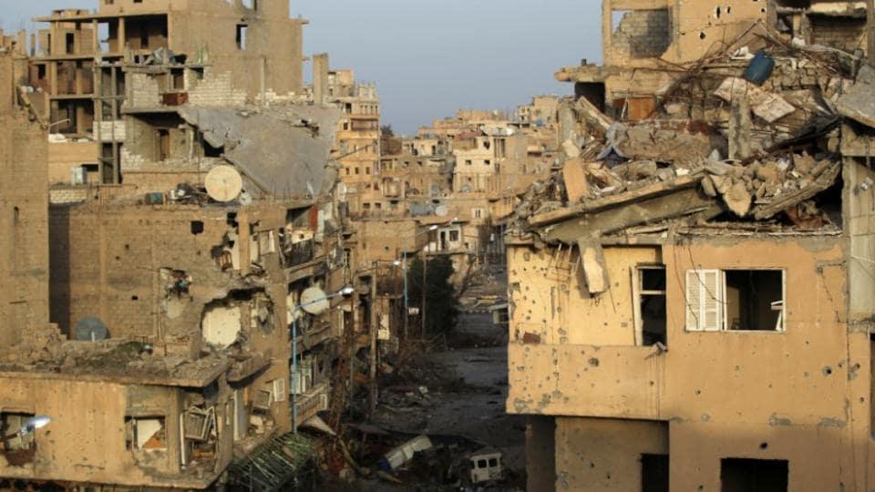 A view shows damaged buildings in Deir al-Zor, eastern Syria February 19, 2014.