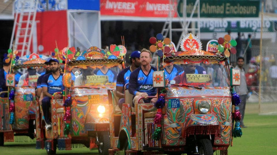 World XI players arrive on the pitch in rickshaws painted with truck art at Ghaddafi Cricket Stadium to play in the World XI cricket series in Lahore, Pakistan September 12, 2017. (Mohsin Raza / Reuters)