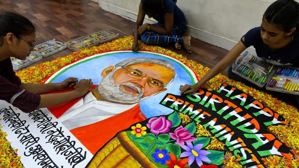 Students from Gurukul School of Art in Mumbai draw a painting of PM Narendra Modi to wish him on his birthday.