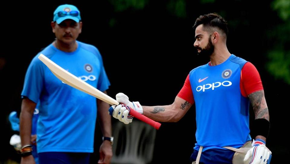 Indian cricket team captain Virat Kohli and head coach Ravi Shastri during a practice session at MAC Stadium on the eve of the first ODI match against Australia, in Chennai on Saturday.