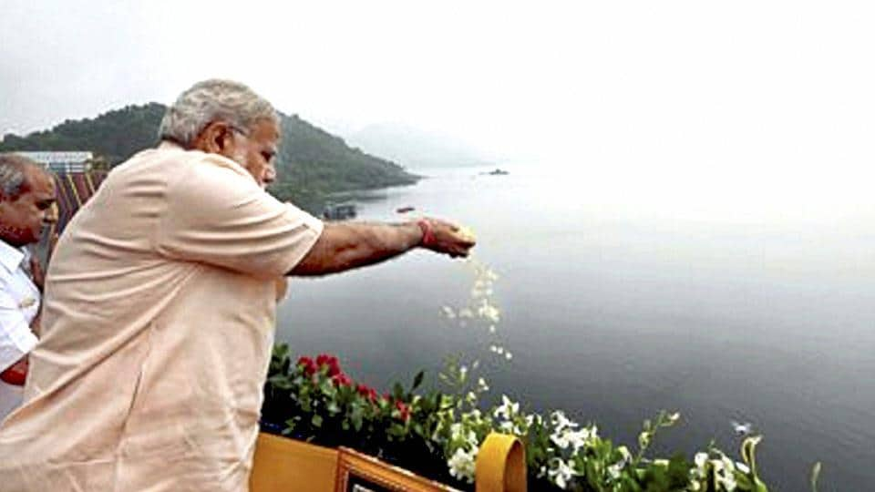 Prime Minister Narendra Modi offers prayers to Narmada River during the inauguration of Sardar Sarovar Dam at Kevadiya in Narmada district on Sunday.