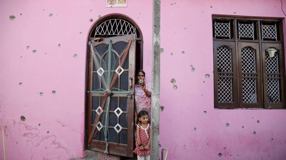 \Bullet marks on the wall of a house after firing by Pakistan forces in Jammu and Kashmir's Arnia sector.
