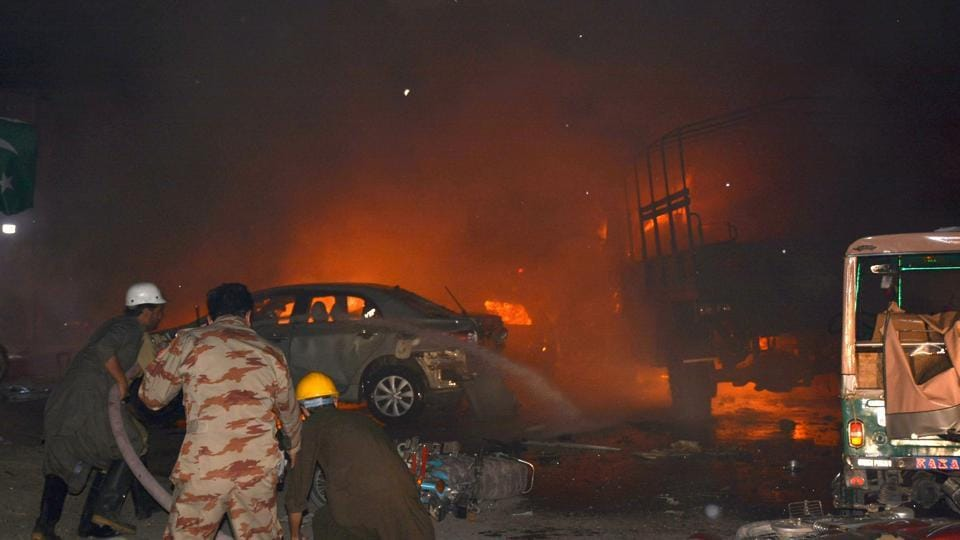 Pakistani firefighters use hoses to try to extinguish burning vehicles after a blast in Quetta on August 12 this year. Violence in Pakistan has declined in recent years following a series of military offensives. But several militant groups are still active in the country, particularly in the northwest.